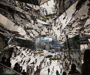 Amazing Mirrored Structure Surrounds Escalator