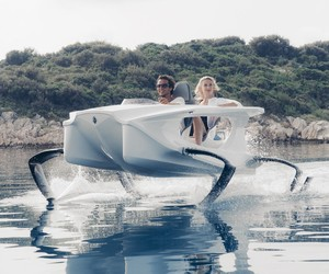 Quadrofoil Electric Watercraft. Flying Over Water