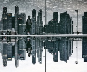 Singapore's Urban Landscapes Reflected in Puddles