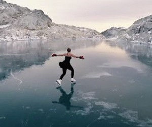 Figure skating in front of an impressive mountain