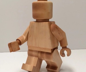 Oversized, wooden LEGO model figure