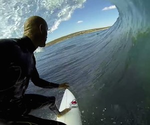 POV Surfing: Kelly Slater and Dolphins