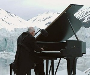 Pianist Gives A Performance On A Floating Iceberg