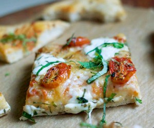 Homemade Pizza with cherry tomatoes & fresh basil