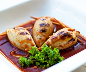 Stuffed squid in shellfish sauce