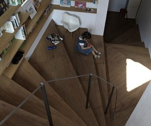 Coil Home Centered Around Large Staircase