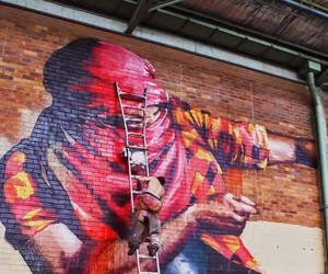 Graffiti artists paints an entire warehouse!
